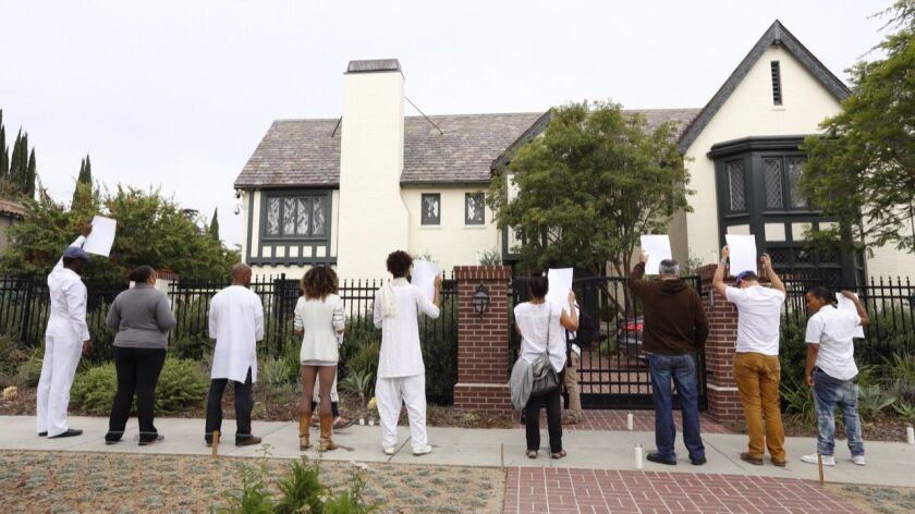 Protesters gathered outside Mayor Eric Garcetti's home on June 7, 2015, calling for him to take action over the fatal shooting of Ezell Ford.