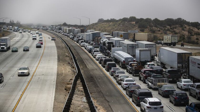 Heavy fog triggers chain-reaction pileup of up to 30 cars in Cajon