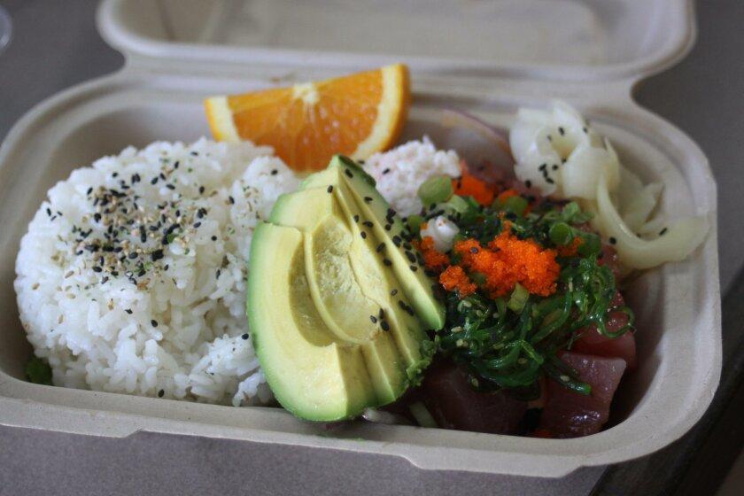 A poke plate from Poke Go, features ahi tuna, seaweed, ginger and avocado.