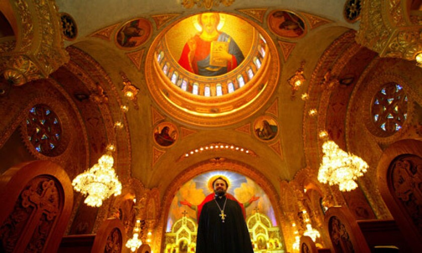 Father John Bakas basks in the splendor of St. Sophia Greek Orthodox Cathedral in the Byzantine-Latino quarter near downtown Los Angeles.