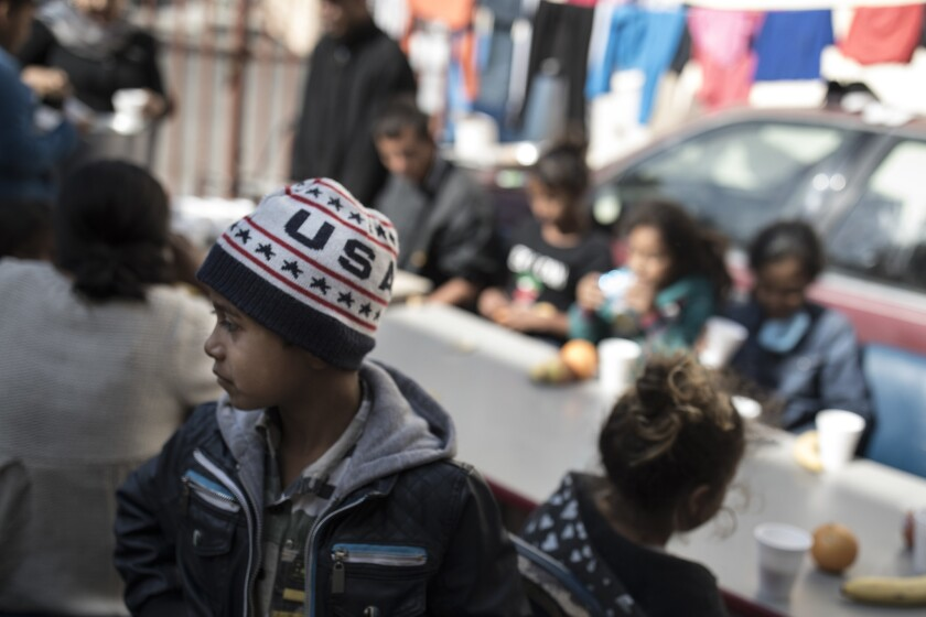 """Children have their breakfast at the """"Vina de Tijuana AC"""" migrant shelter in Tijuana, Mexico, Arpril 28, 2018. The migrants were preparing to walk to the """"Casa del Tunel"""" to get legal advice from U.S. immigration lawyers."""