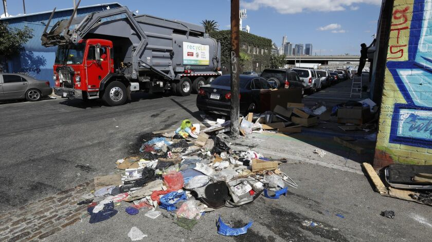 A pile of trash sits uncollected on Santee St. between 18th St. and Washington Blvd in the fashion district of Los Angeles on Oct. 11.