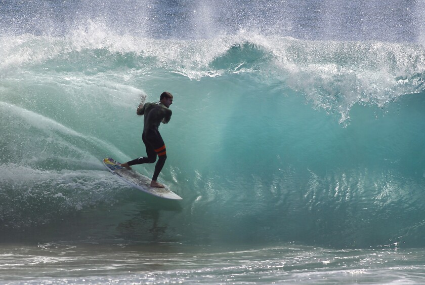 A surfer hits the waves at the Wedge in Newport Beach in October. Fifteen-foot waves are expected there this weekend.