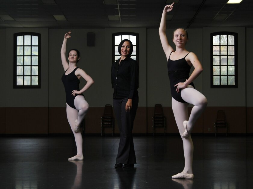 Molly Terbovich-Ridenhour, Executive Director of the San Diego Civic Youth Ballet with dancers Madison Gardner, left, and Veronica Lee.