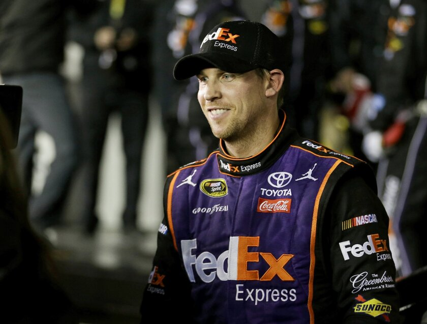 Denny Hamlin smiles during an interview after he won the Sprint Unlimited auto race at Daytona International Speedway, Saturday, Feb. 13, 2016, in Daytona Beach, Fla. (AP Photo/John Raoux)