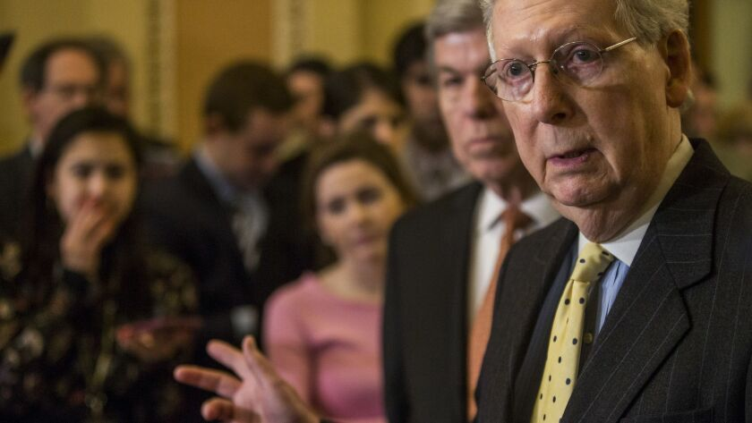 Senate Majority Leader Mitch McConnell (R-KY) speaks during a news conference following a weekly policy luncheon in Washington on April 2.