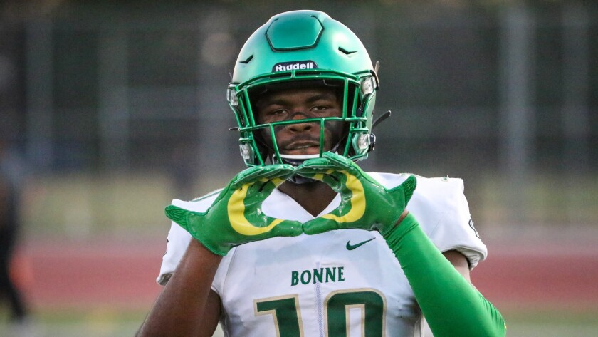 Narbonne defensive back Anthony Beavers Jr. shows off his Oregon gloves before a game against St. Paul.