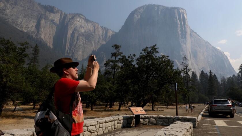 YOSEMITE, CALIF. -- TUESDAY, AUGUST 14, 2018: Steve Maddison, of Holland, photographs El Capitan as