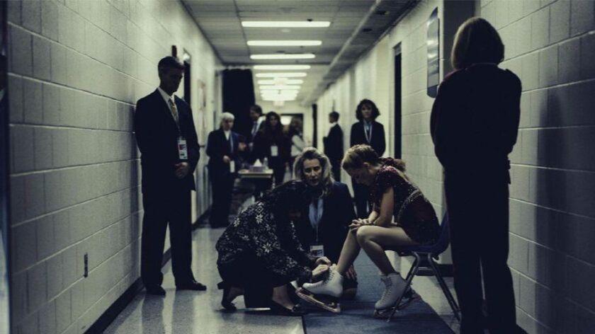 """Margot Robbie as Tonya Harding, seated, right, in a scene from """"I, Tonya."""""""