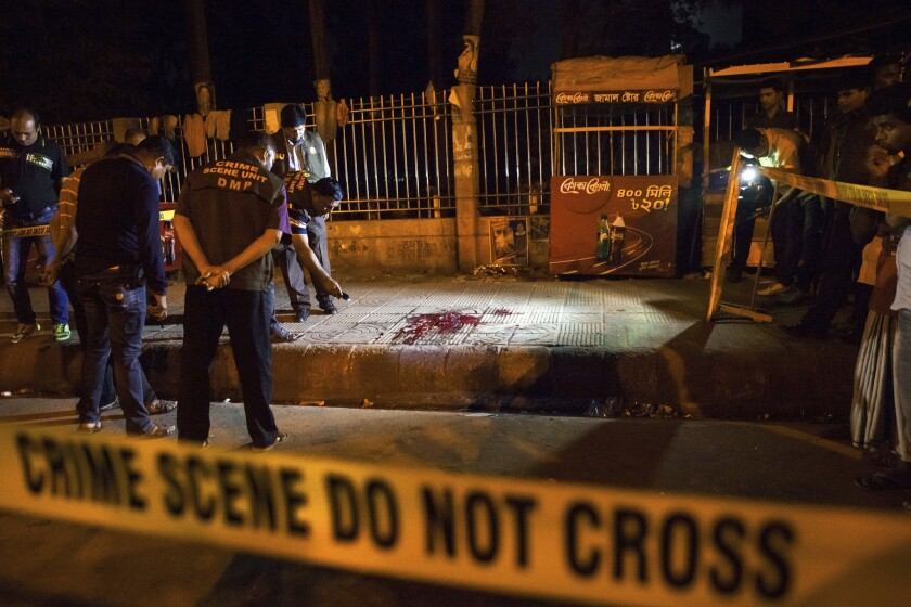 In this February 2015 photo, police investigate the scene of the attack on blogger Avijit Roy in Dhaka, Bangladesh.