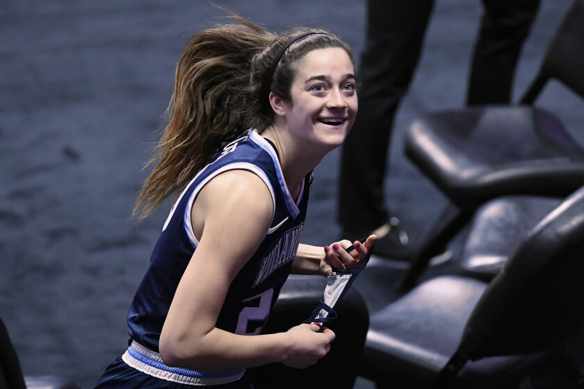 Villanova's Maddy Siegrist smiles as she looks up at a small number of friends and family of the athletes allowed to view the game after an NCAA college basketball game against DePaul in the quarterfinals of the Big East Conference tournament at Mohegan Sun Arena, Saturday, March 6, 2021, in Uncasville, Conn. (AP Photo/Jessica Hill)