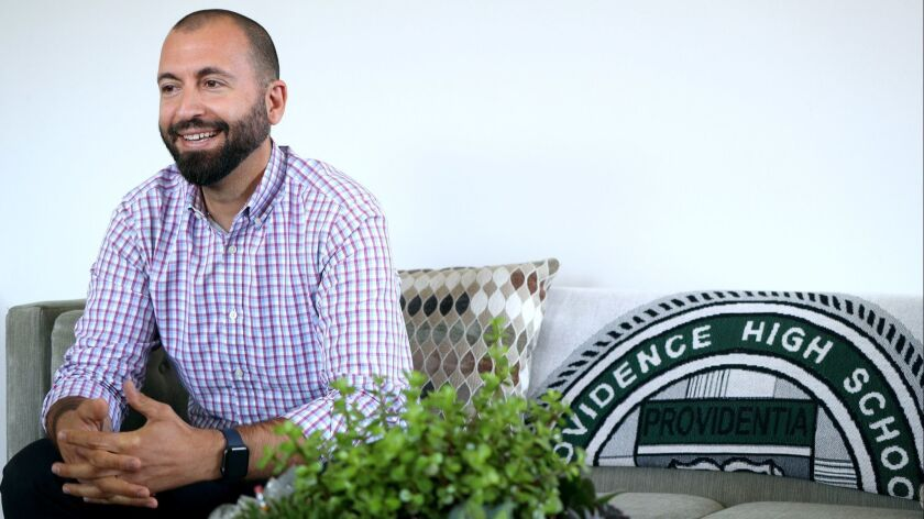 Scott McLarty is the new head of school at Providence High School, in his office at the Burbank scho