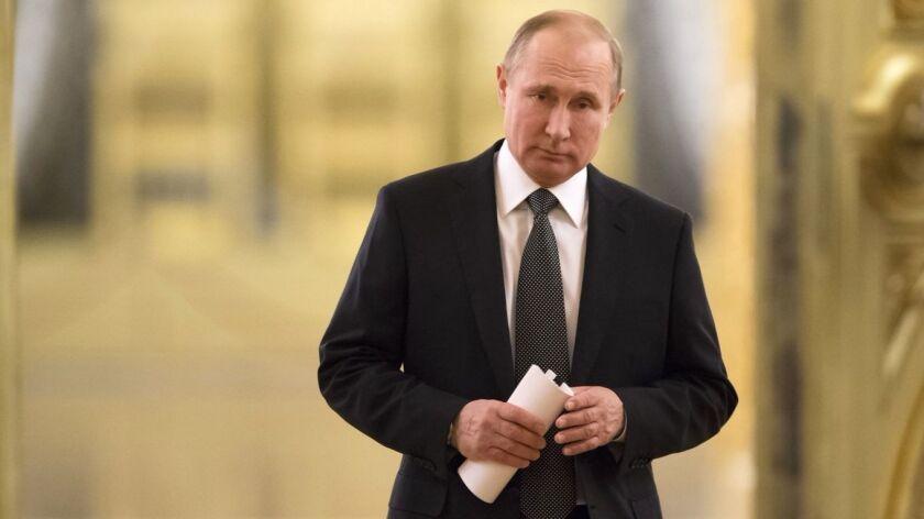 FILE In this file photo taken on Thursday, April 5, 2018, Russian President Vladimir Putin enters a