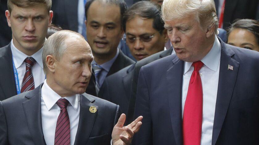 Vladimir Putin and Donald Trump at the APEC Summit in Da Nang, Vietnam, on Nov. 11, 2017.