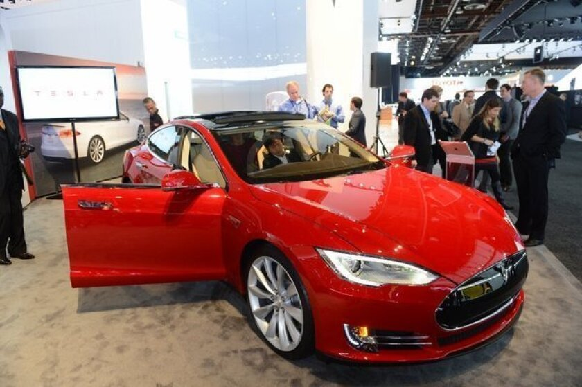 The Tesla Model S is introduced at the 2013 North American International Auto Show in Detroit in January. In the latest chapter of an ongoing battle against traditional dealer networks, Tesla Chief Executive Elon Musk has taken his fight to Texas, telling lawmakers his company could sell as many as 2,000 cars there next year if allowed to open its own stores.