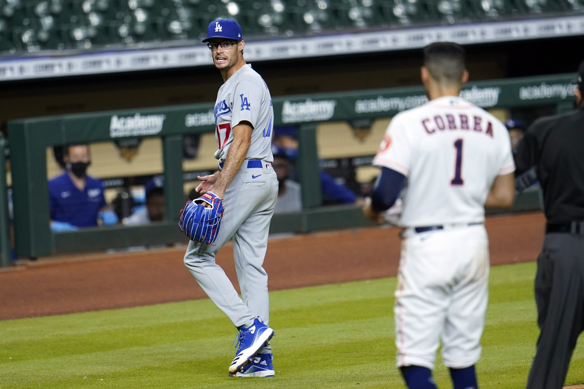 Dodgers relief pitcher Joe Kelly yells back at the Houston Astros' Carlos Correa