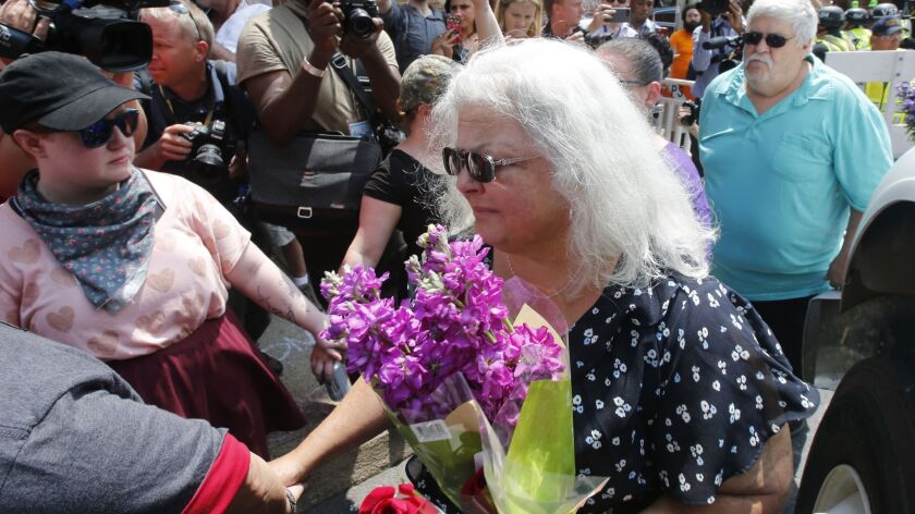 Susan Bro, center, the mother of Heather Heyer, the civil rights activist who was killed at a white nationalist rally in Charlottesville, Va., last year, speaks in August to supporters.