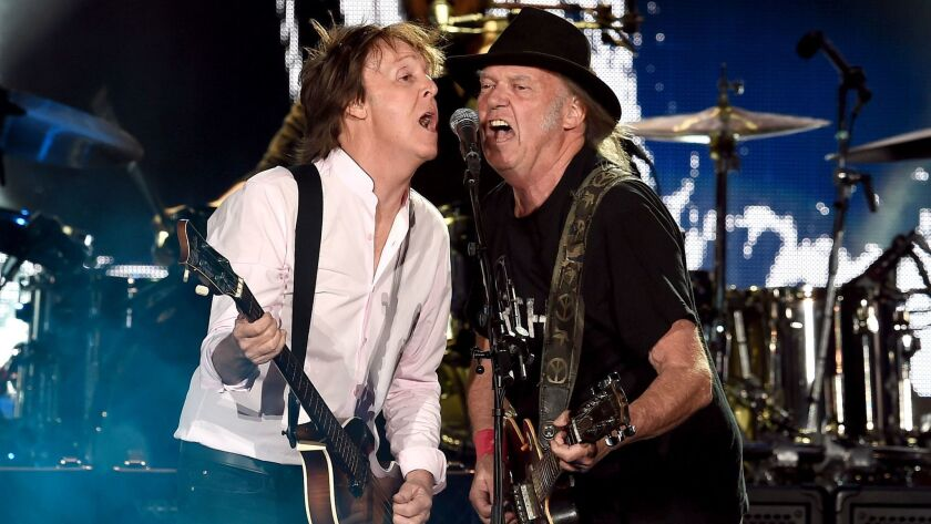 Sir Paul McCartney and Neil Young perform onstage during Desert Trip at the Empire Polo Field on Oct. 8 in Indio.