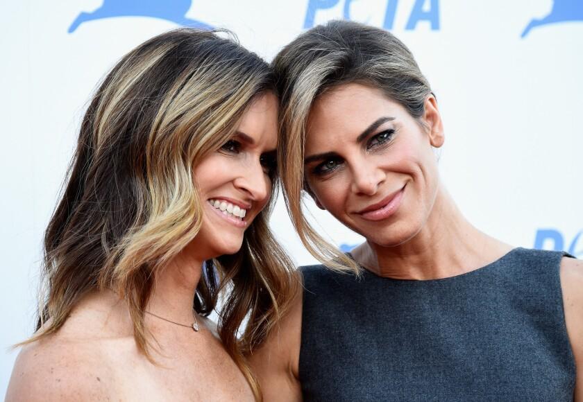 Fitness star Jillian Michaels, right, is engaged to partner Heidi Rhoades.