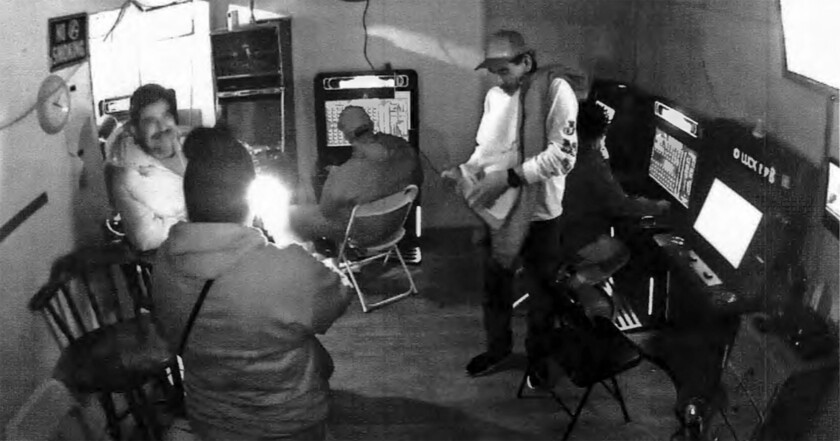 Surveillance footage seen inside a suspected illegal gambling parlor in San Diego on Oct. 28, 2020.