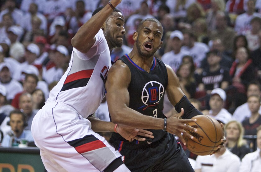 Clippers guard Chris Paul, right, drives to the basket past Portland Trail Blazers forward Maurice Harkless during the first half of Game 3 of the Western Conference first-round playoffs on April 23.