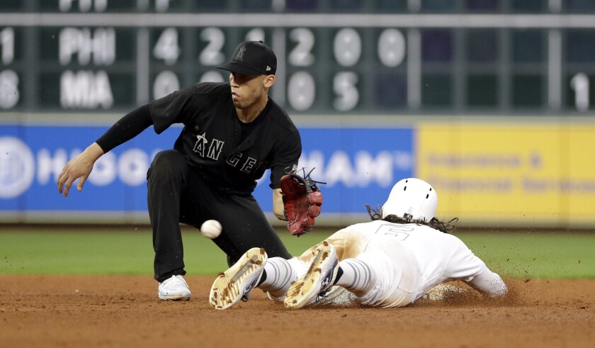 Angels shortstop Andrelton Simmons catches a throw from catcher Anthony Bemboom