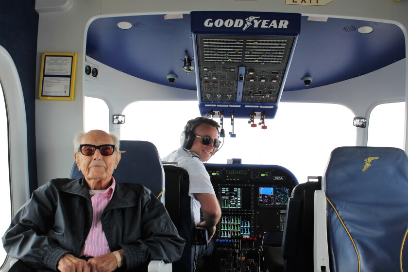 Glenn Quillin, 103, sits with captain Bill Bayliss during a cruise over Los Angeles aboard the Goodyear blimp Wingfoot Two on Friday morning.