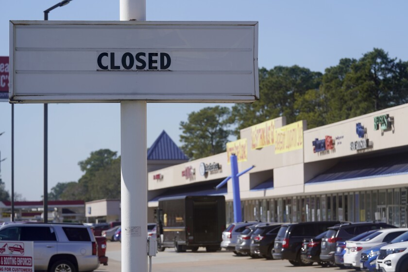 The closed sign of a former restaurant is displayed at a shopping center Wednesday, Jan. 13, 2021, in Houston. The latest figures for jobless claims, issued Thursday, Jan. 14, by the Labor Department, remain at levels never seen until the virus struck. (Melissa Phillip/Houston Chronicle via AP)
