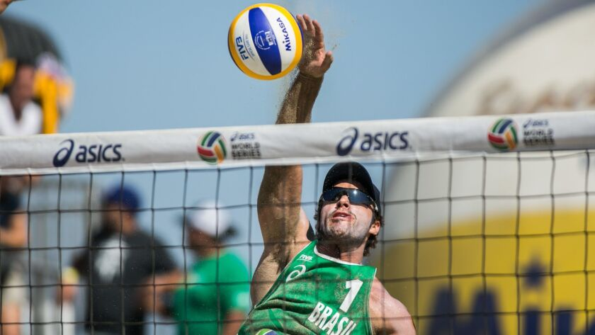 LONG BEACH, CALIF. -- SUNDAY, AUGUST 23, 2015: Bruno Schmidt spikes the ball back towards the USA co