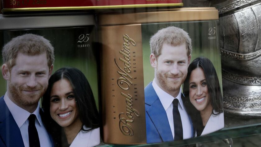 Memorabilia with a photograph the image of Britain's Prince Harry and Meghan Markle are displayed fo