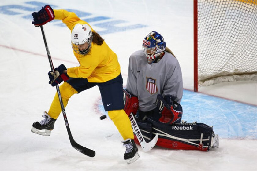 U.S. women's hockey player Alex Carpenter takes a shot against teammate Brianne McLaughlin during a training session Monday at Shayba Arena ahead of the Sochi 2014 Winter Olympics.
