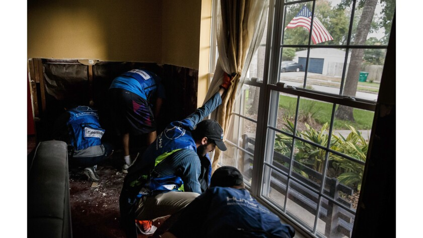 Volunteers attended prayer services in the morning, then helped storm victims haul away damaged furn