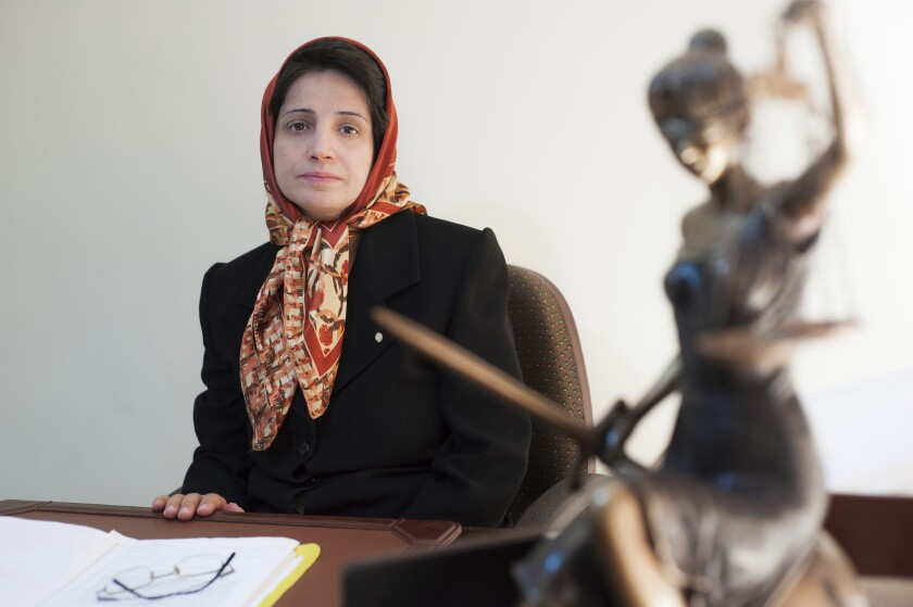 FILE - In this Nov. 1, 2008 file photo, Iranian human rights lawyer Nasrin Sotoudeh, poses for a photograph in her office in Tehran, Iran. Reza Khandan, the husband of Sotoudeh told The Associated Press on Thursday, Aug. 13, 2020, that his wife began a hunger strike Tuesday seeking the release of political prisoners. Khandan said he feared it would exacerbate her chronic gastrointestinal and foot problems. Sotoudeh, a mother of two, was arrested in 2018 on charges of collusion and propaganda against the system and eventually was sentenced to 38 years in prison and 148 lashes. (AP Photo/Arash Ashourinia, File)