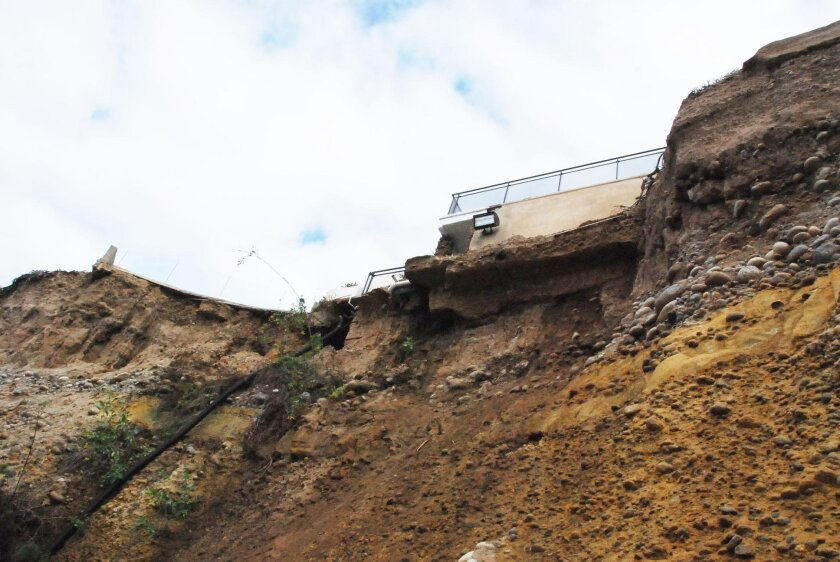 THEN: The bluff top property at 417 Sea Ridge Drive after the cliff collapse in September 2015.