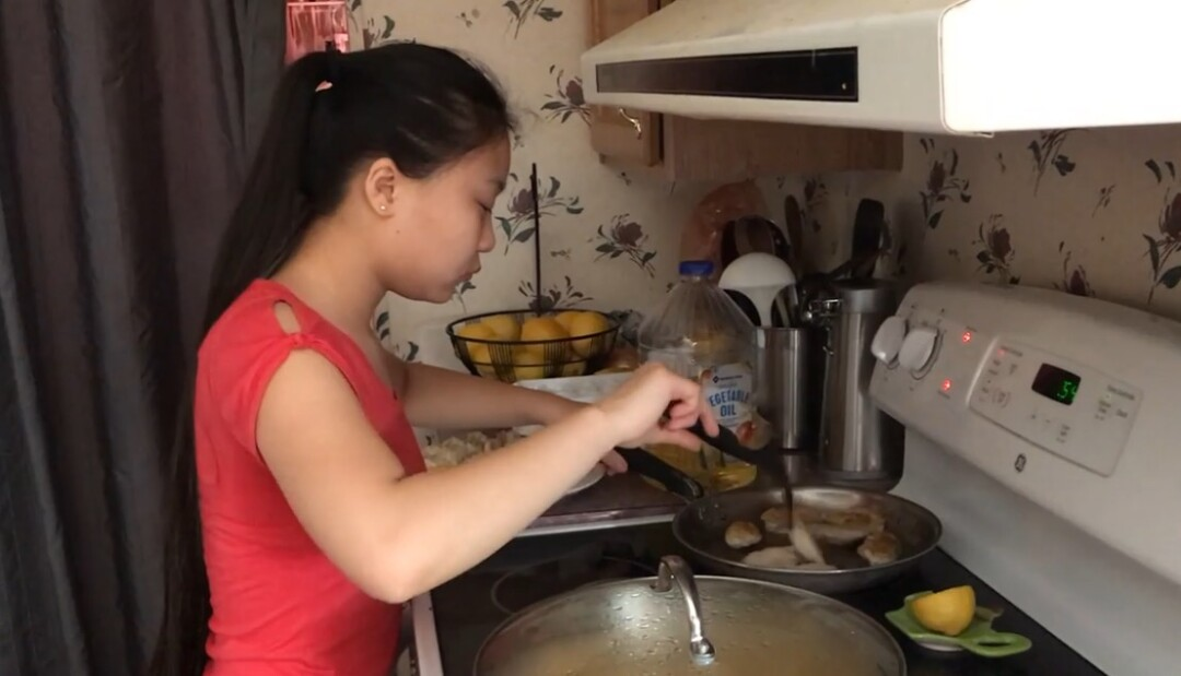 Esther cooking at home