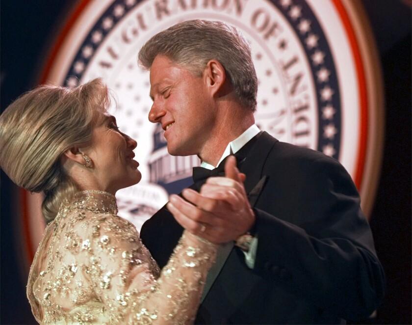 Bill and Hillary Clinton dance in January 1997.