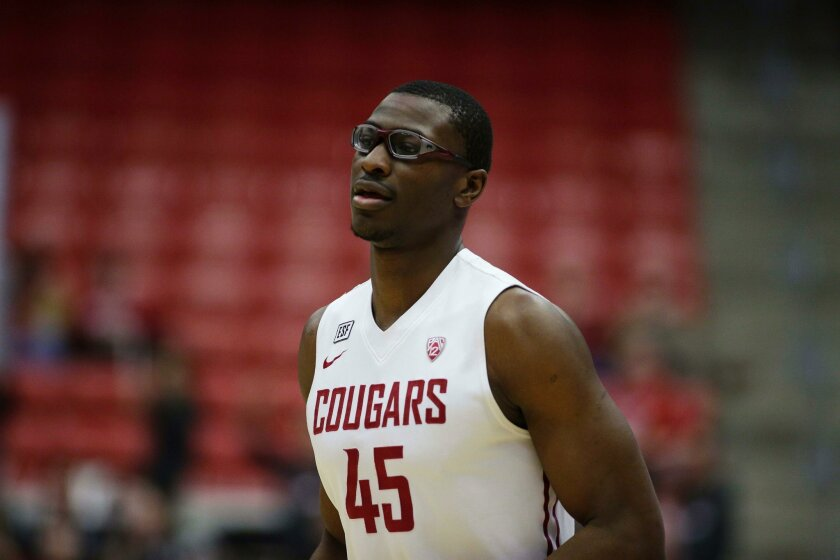 Washington State's Valentine Izundu (45) walks on the court during the first half of an NCAA college basketball game against Arizona State, Saturday, Feb. 6, 2016, in Pullman, Wash. (AP Photo/Young Kwak)