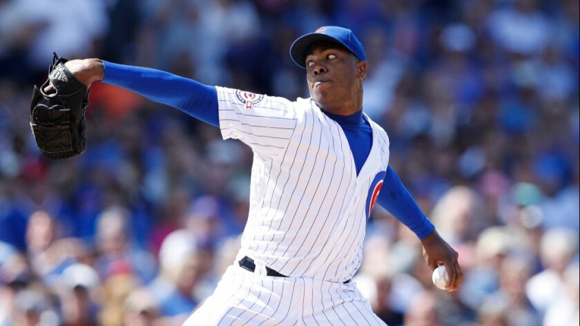 Closer Aroldis Chapman's first pitch in debut with the Cubs was clocked at 101 mph and his last at 103 mph.