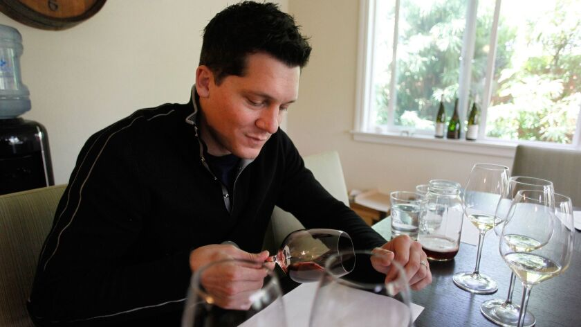 Josh Orr prepares for The Master Sommelier exam with a blind tasting practice exam. Orr is one of three San Diegans taking The Master Sommelier exam in Aspen May 17.