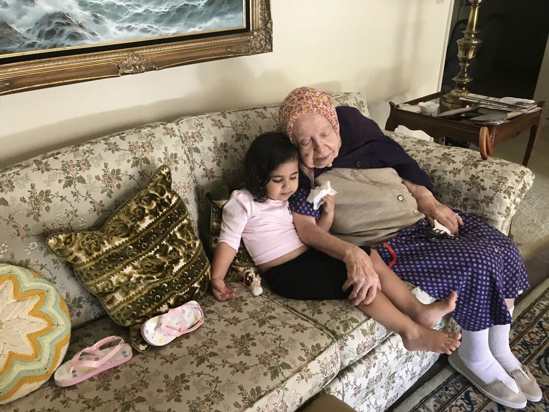 Malia Urdahl, 4, sits with 102-year old Clara Margossian in her Fresno home.