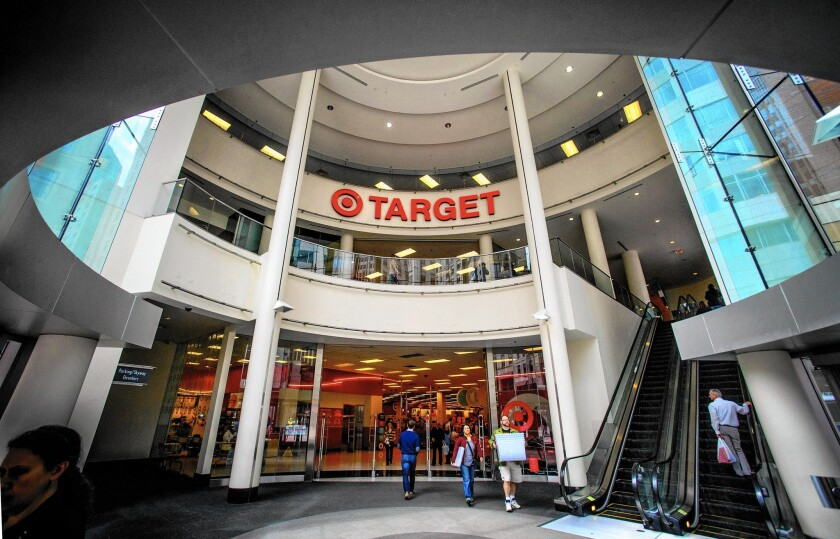 Target spent $248 million after hackers stole 40 million payment card accounts and the personal information of up to 70 million customers. The insurance payout, according to Target, will be $90 million. Above, a Target store in Minneapolis.