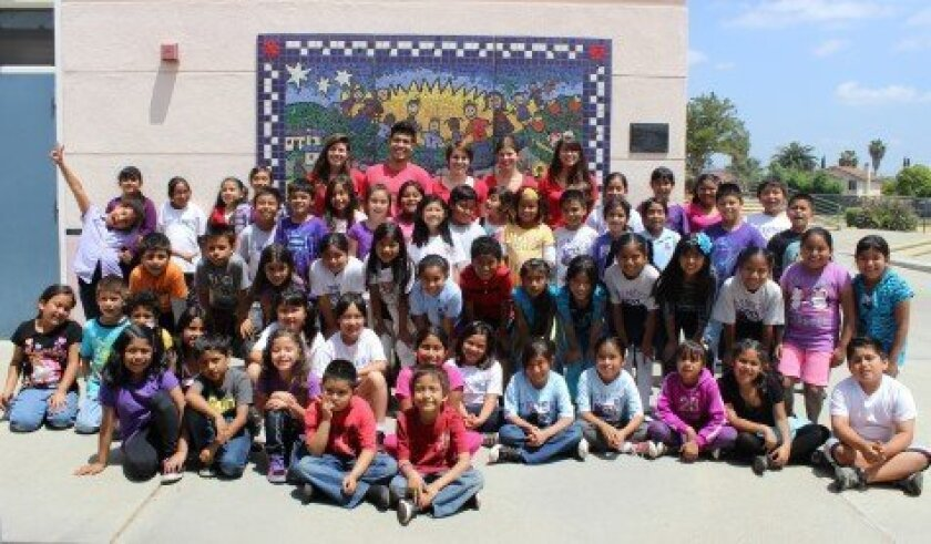 CCA students with students from Pioneer Elementary School. (CCA students are wearing red shirts.) Courtesy photo