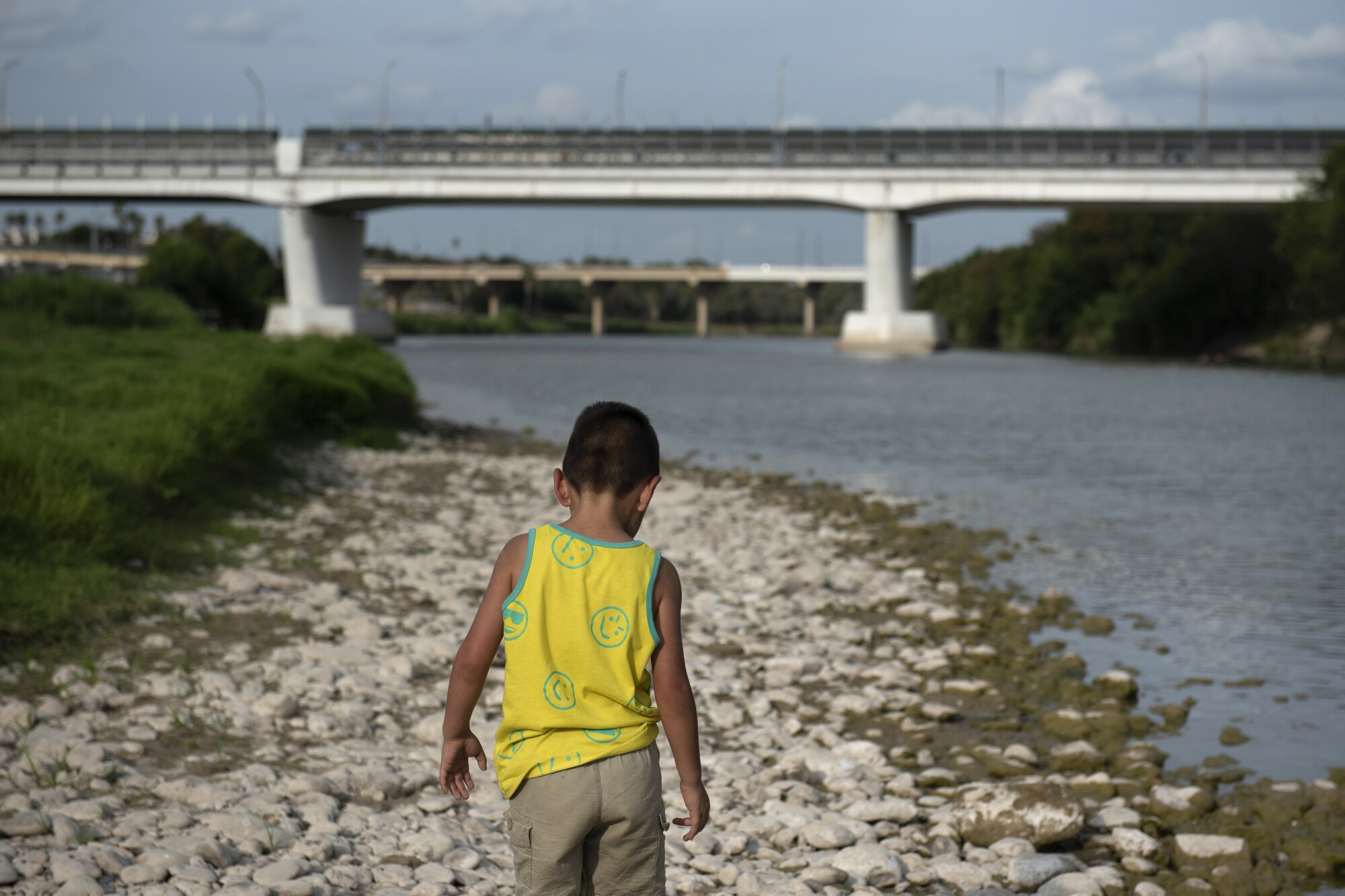 A child walks along the bank of the Rio Grande in Laredo, Texas.