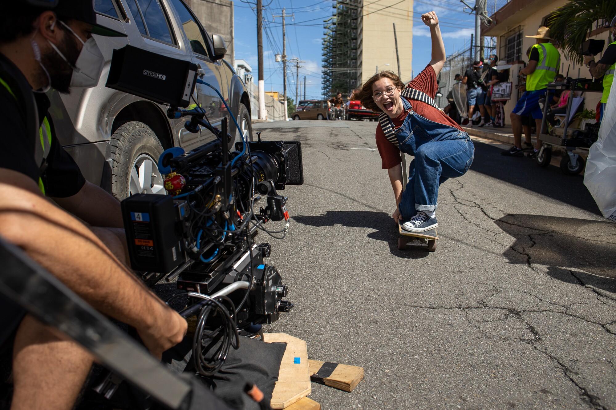 "Melanie Ramos skates for the camera as filming resumes on ""Simone."""