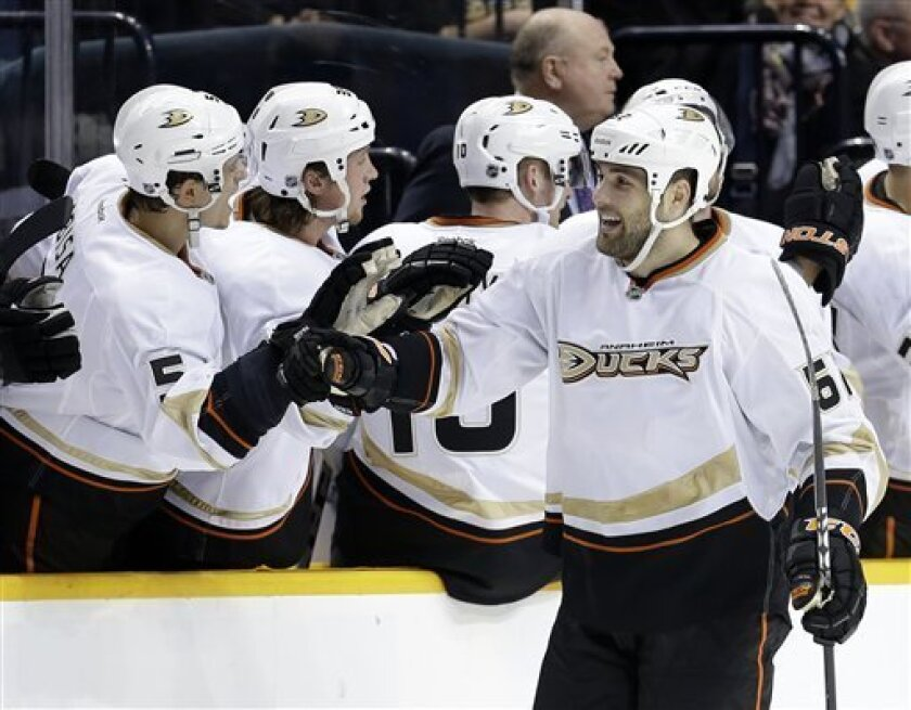 Anaheim Ducks left wing Patrick Maroon, front, is congratulated by Luca Sbisa (5), of Italy, after Maroon scored against the Nashville Predators in the second period of an NHL hockey game Saturday, Feb. 16, 2013, in Nashville, Tenn. (AP Photo/Mark Humphrey)