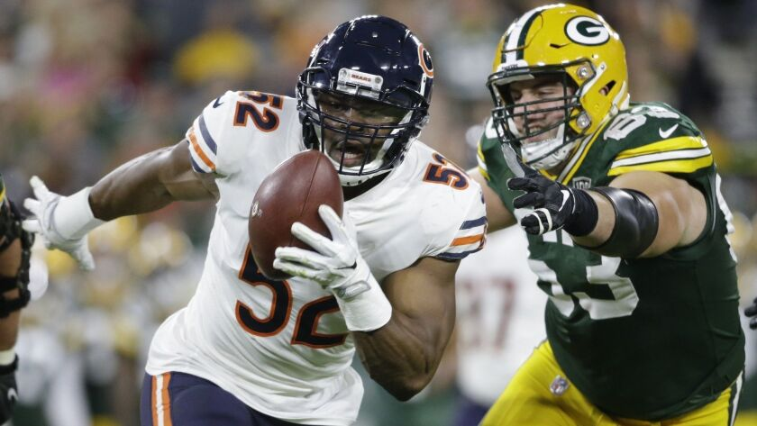 FILE - In this Sunday, Sept. 9, 2018, file photo, Chicago Bears' Khalil Mack (52) intercepts a pass