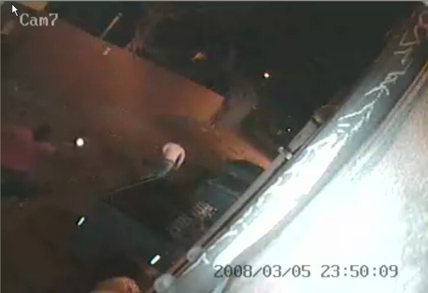 This video frame from a surveillance camera shows a confrontation between off-duty Deputy U.S. Marshall Matthew Itkowitz, left, and Ryan Gonzalez on March 5, 2008, in an alley off Melrose Avenue. Gonzalez was shot and killed during the confrontation.