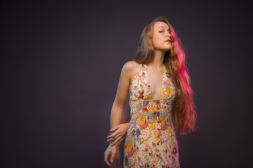 Harpist and singer-songwriter Joanna Newsom, photographed in the Los Angeles Times studio in downtown Los Angeles. Her recent statements about Spotify prompted an official reply from the company.