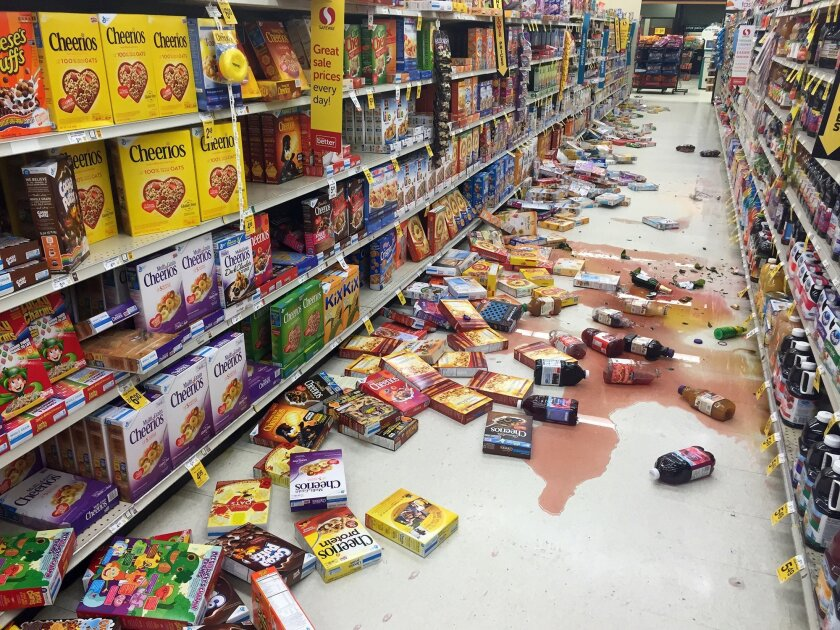 Boxes of cereal and bottles of juice lie on the floor of a Safeway store on the Kenai Peninsula after the earthquake.