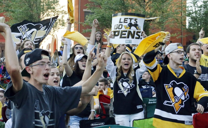 Fans cheer outside the Consol Energy Center before Game 1 of the Stanley Cup final series between the San Jose Sharks and the Pittsburgh Penguins Monday, May 30, 2016, in Pittsburgh. (AP Photo/Keith Srakocic)